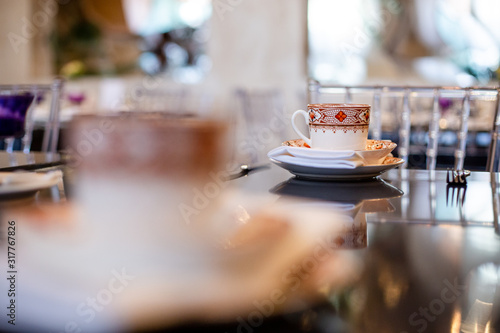 tea cup on the table during the tea ceremony in the style of the English aristoc Canvas Print