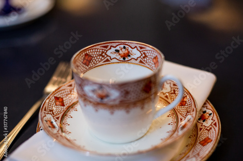 tea cup on the table during the tea ceremony in the style of the English aristoc Wallpaper Mural