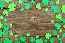St Patricks Day Frame Of Shamrock Decorations. Top View Over An Old Rustic Wood Background. Copy Space.