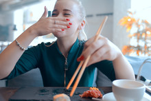 Girl Eats Sushi And Rolls In A...