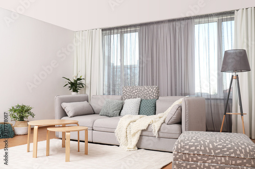 Fotografia Windows with stylish curtains in living room interior