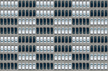 Aerial View Of Large Number Of Black And White Cars Arranged In Checked Pattern