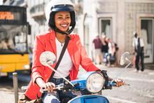 Smiling Young Woman Riding Mot...