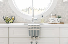 Tea Towel On Sink With Mugs At...