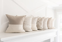 Neutral Pillows On A Fireplace...