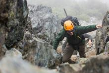 Mountaineer Climbing A Rocky M...