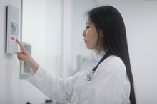 Asia Woman Doctor Checking Dev...