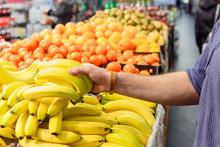 Mans Hand Take Bananas From Sh...