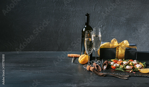 Fototapeta romantic veggie dinner for two on valentines day with champagne and salad obraz