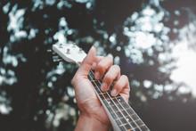 Close-Up Of Hand Playing Guita...