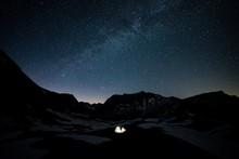 Illuminated Tent On Land At Ni...