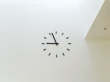 Low Angle View Of Clock On Whi...