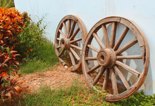 Two Old Wagon Wooden Wheels.