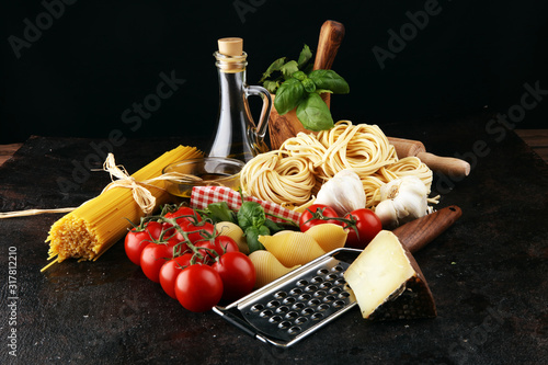 Fotografiet Pasta, vegetables, herbs and spices for Italian food on rustic table