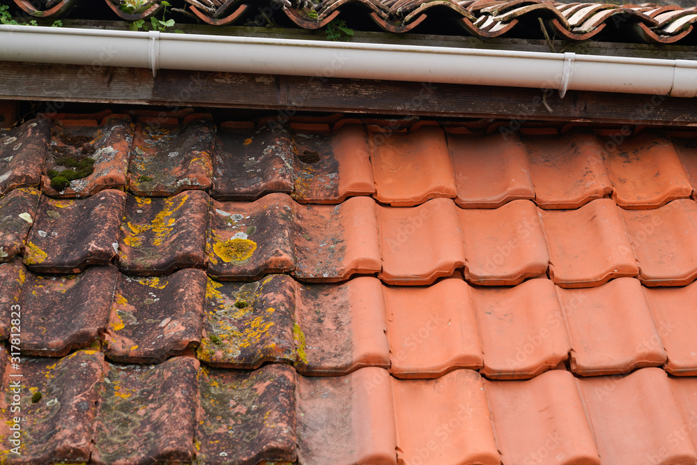 Fototapeta high pressure water cleaner tile after and before industrial roof cleaning