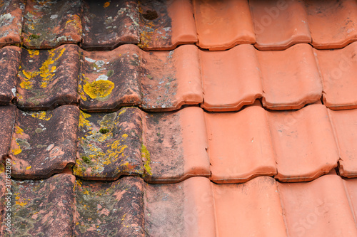 Obraz Comparison roof top before and after cleaning moss lichen high pressure water cleaner tile - fototapety do salonu