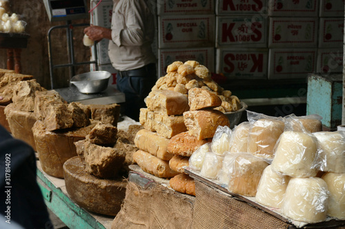 Jaggery raw sugar for sale in market, unrefined palm sugar comes in different colours.  Natural and caramel sweetneess