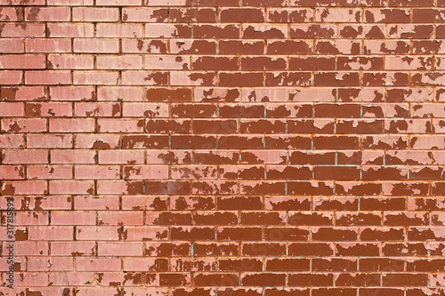 faded red painted brick wall