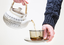 Hand Holding A Cup Of Tea Isol...