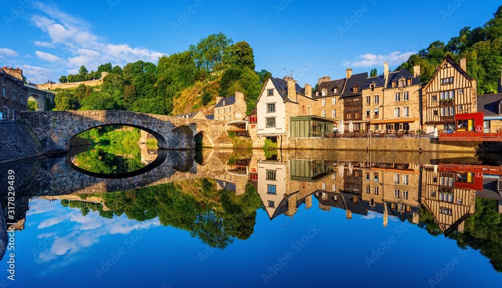 Fototapeta The Old bridge in the port of Dinan town, France