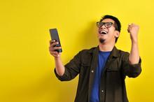 Asian Man Holding Smartphone W...