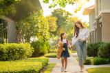 Asian preschool girl walk with her mother to go to school
