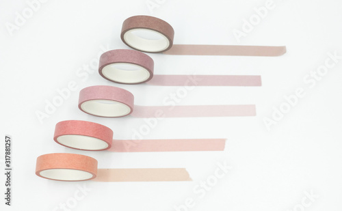 Close up top view of paper masking tape in set of pink arranging in a row and taping on board Wallpaper Mural