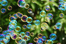Many Soap Bubbles On A Blurred...