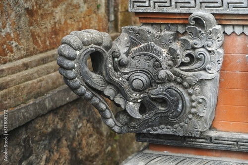 Closeup detail of stylized stone elephant head at a Hindu temple in Bali Indones Wallpaper Mural