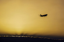 Jet Plane Landing In Sunrise T...