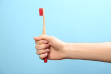 Woman Holding Bamboo Toothbrus...