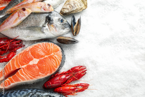 Fresh fish and seafood on ice, flat lay Fototapet
