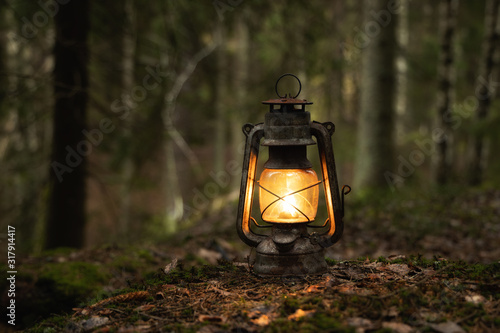 Lantern standing on a ground in the deep forest, Hiker Concept image, copyspace for your individual text Fototapet