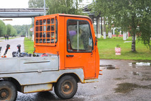 Small Orange Open Truck Electric Tent For Transportation Of Small Goods Inside The Enterprise Of The Plant