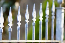 Closeup Shot Of A White Picket Fence With A Blurred Background