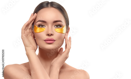 Canvas Print Woman with under eye collagen gold pads, beauty model girl face with healthy fresh skin