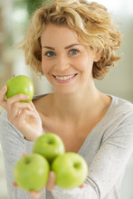 Happy Woman Holding Green Apples