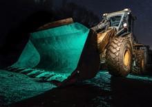 Close-Up Of Bulldozer At Night