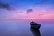 canvas print picture - Dramitc sunset with boat on beach