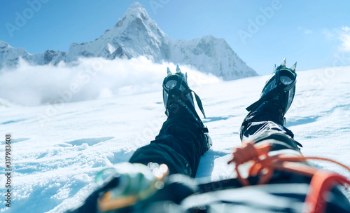 Fotografie, Obraz POV shoot of a high altitude mountain climber's lags in crampons