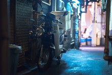 Motor Scooter In Alley AT NIGHT