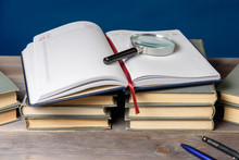 An Open Notebook, Glasses, A P...