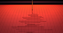 Red Alert A Closeup Of A Seismograph Machine Needle Drawing A On Graph Paper Depicting Seismic And Earthquake Activity - 3D Render