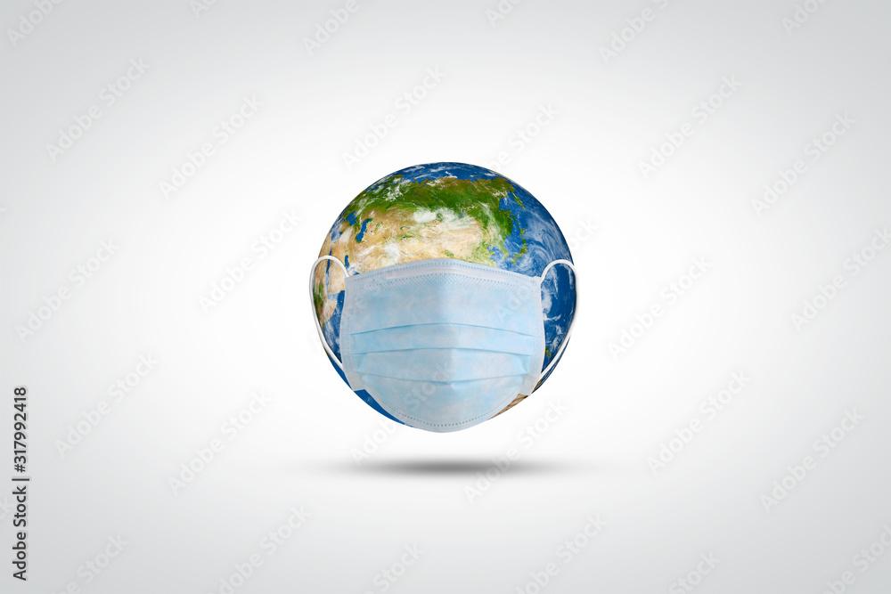 Fototapeta Coronavirus/ corona virus concept. World or earth put mask to fight to fight against coronavirus. Concept of fight aginst virus and world pollution