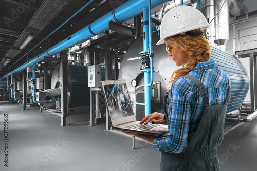 Fotografie, Tablou Attractive Caucasoid engineer woman with laptop inspect modern industrial gas boiler room