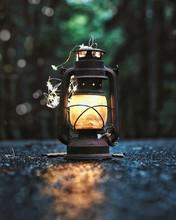 Close-Up Of Vintage Lantern On Road