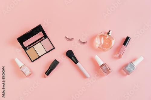 Fotografiet Woman cosmetics and make up on pink background, Top view