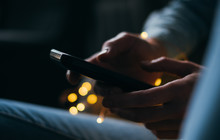 Cropped Image Of Person Using Phone At Night