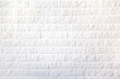 Leinwanddruck Bild - Background of a white decorative brick wall with a seam. Interior, backgrounds, structure.