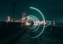 Light Painting On Road Against Sky In City At Night